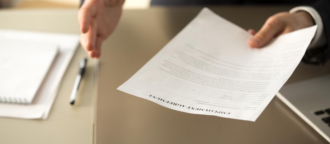 Employer offering job, businessman extending employment agreement