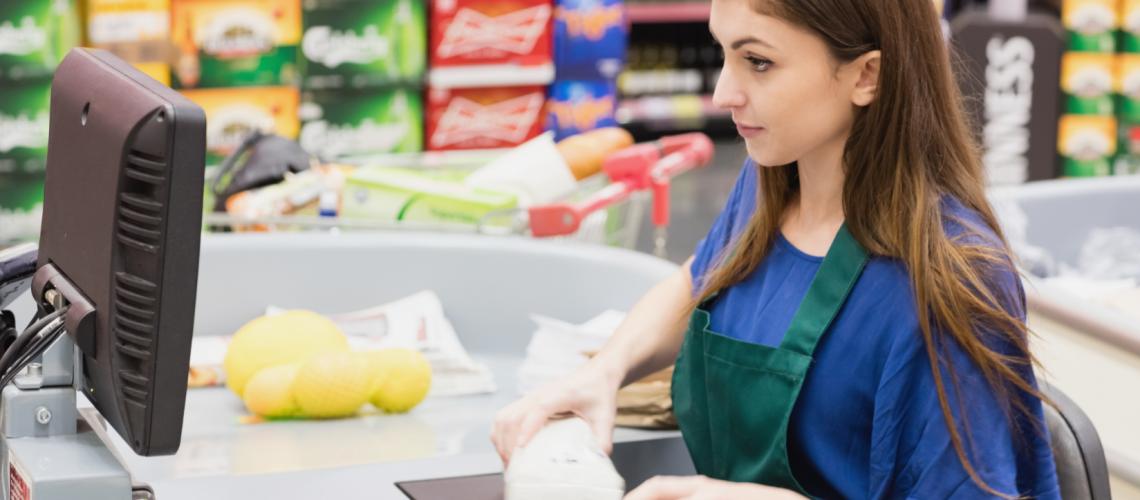 Woman cashier beeping an item
