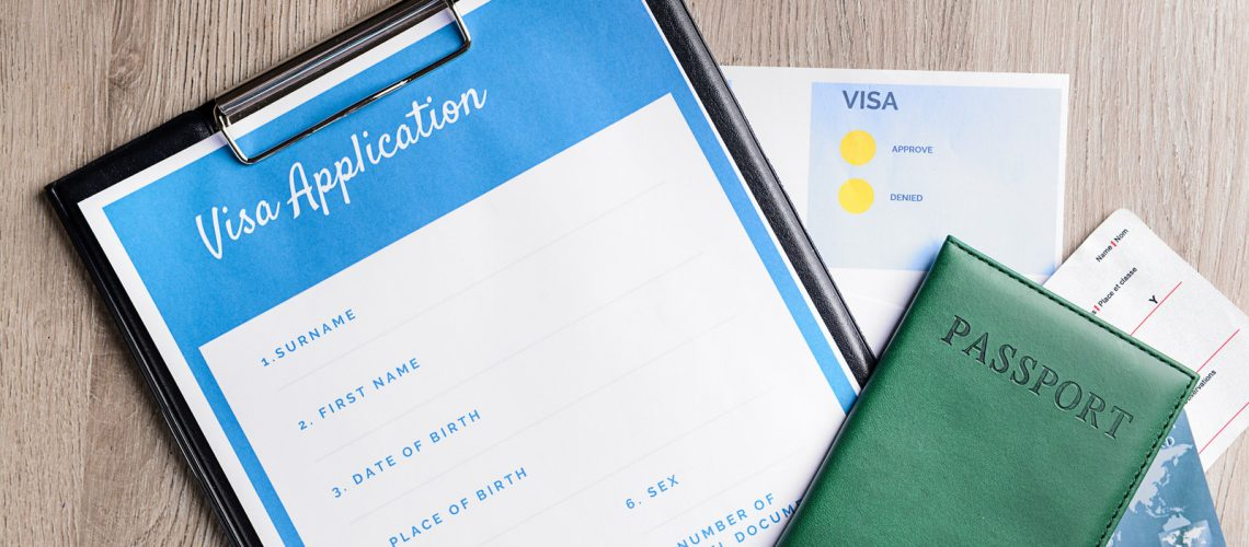 Visa application form, passport and documents on table. Concept of immigration